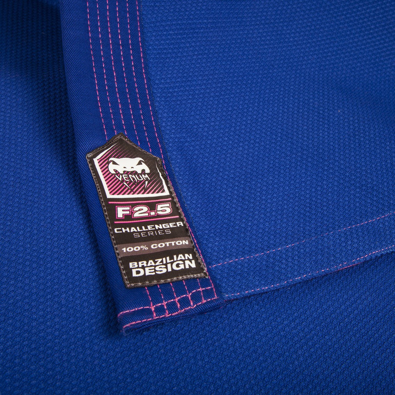 Venum Challenger 2.0 Female Gi Blue and pink.  The new Female challenger 2.0 gi is available in blue at www.thejiujitsushop.com   Enjoy free shipping from The Jiu Jitsu Shop.  Top BJJ gear from the best brands at low prices and free shipping for men, women and kids.