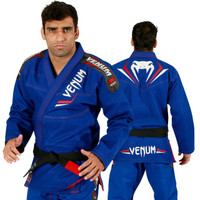 Venum Elite Jiu Jitsu Gi in Royal Blue and Red.  Now available at www.thejiujitsushop.com Front of gi in Blue  and Red   Enjoy free shipping from The Jiu Jitsu Shop.  Top quality brazilian jiu-jitsu gear for men women and kids.