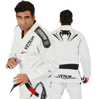 Venum Elite Jiu Jitsu Gi in white and silver.  Now available at www.thejiujitsushop.com Front of gi is white with great silver accents   Enjoy free shipping from The Jiu Jitsu Shop.  Top quality brazilian jiu-jitsu gear for men women and kids.