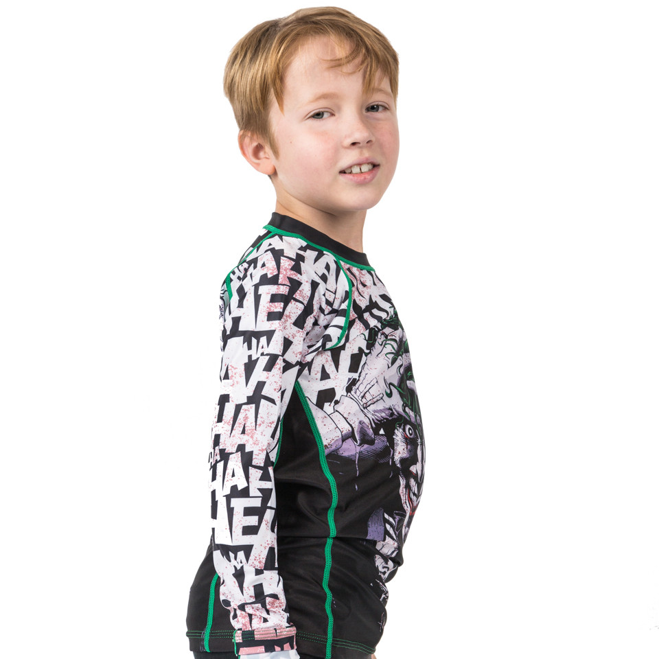 side view for the kids rashguard Fusion FG Batman The Killing Joke Kids BJJ Rashguard is available at www.thejiujitsushop.com  Officially licensed Batman Gear.   Enjoy Free Shipping from The Jiu Jitsu Shop today!