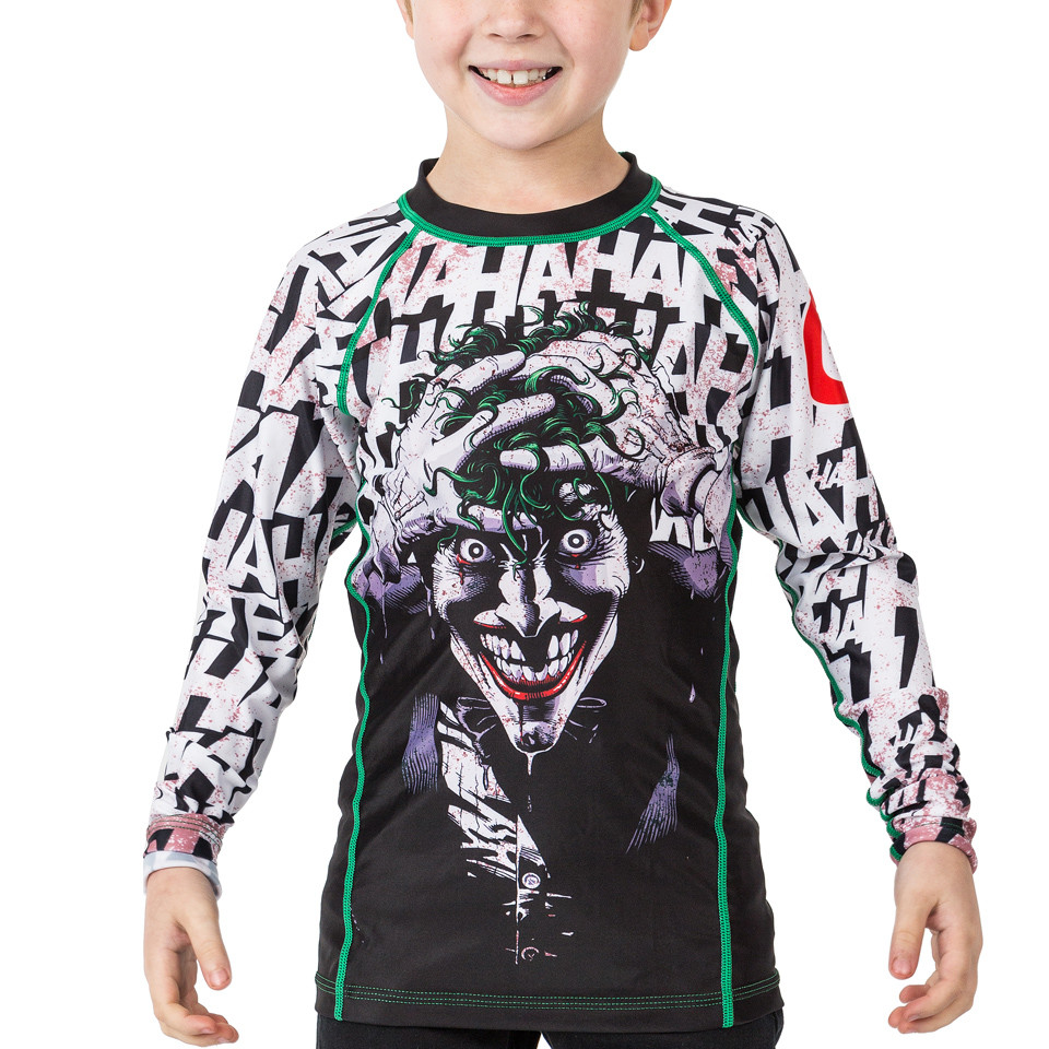 Fusion FG Batman The Killing Joke Kids BJJ Rashguard is available at www.thejiujitsushop.com  Officially licensed Batman Gear.   Enjoy Free Shipping from The Jiu Jitsu Shop today!