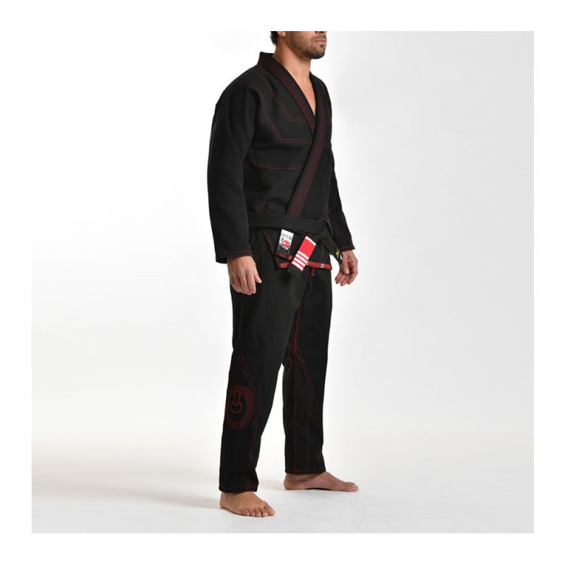 Model diagonal of the Grips athletics Cali 99 Gi black gi.  Available at www.thejiujitsushop.com  Enjoy free shipping from The Jiu Jitsu Shop today!