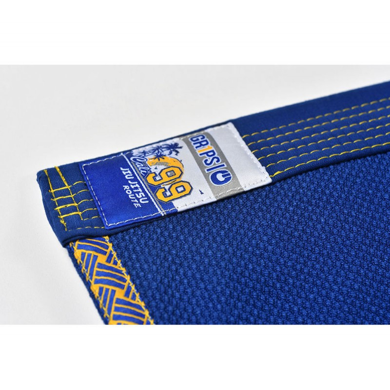 Gi lapel label of the Grips athletics Cali 99 Gi Blue gi.  Available at www.thejiujitsushop.com  Enjoy free shipping from The Jiu Jitsu Shop today!