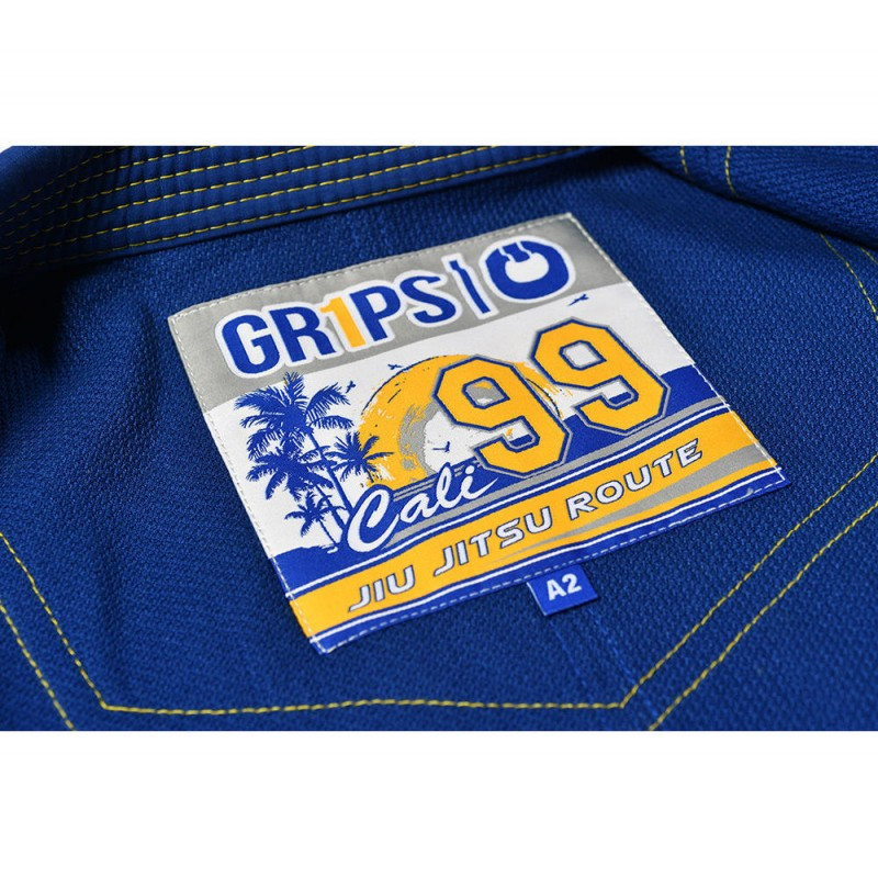 Gi back label of the Grips athletics Cali 99 Gi Blue gi.  Available at www.thejiujitsushop.com  Enjoy free shipping from The Jiu Jitsu Shop today!
