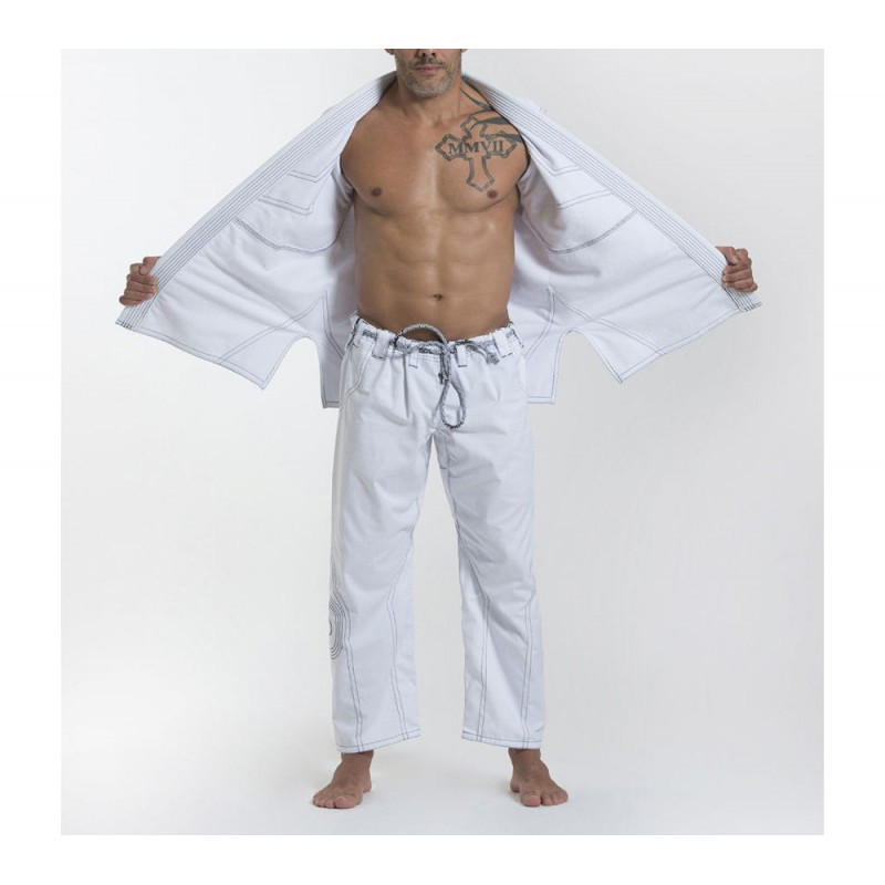 Open gi model Grips athletics Cali 99 Gi White gi.  Available at www.thejiujitsushop.com  Enjoy free shipping from The Jiu Jitsu Shop today!