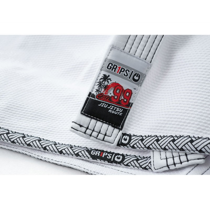 Lapel label of the Grips athletics Cali 99 Gi White gi.  Available at www.thejiujitsushop.com  Enjoy free shipping from The Jiu Jitsu Shop today!