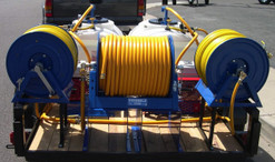 Dual tank termite sprayer.  Extra hose reel tied into the anti-siphon (air gap devices) of both tanks for faster fill