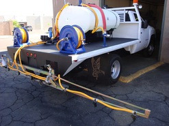 300 Gallon Weed Spray flatbed with folding boom