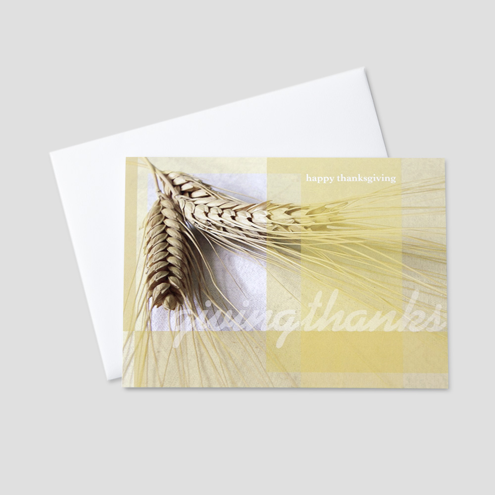 Customer Thanksgiving greeting card featuring wheat and a thanksgiving message and a pale yellow background