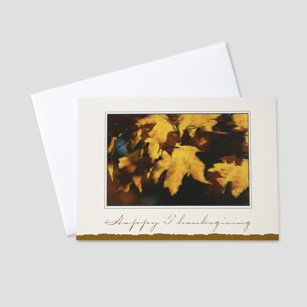 Business Thanksgiving greeting card featuring colorful autumn leaves and a Thanksgiving message on a cream colored background