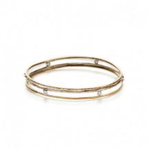 Two-tone floating CZ bangle bracelet