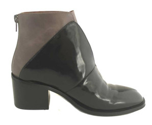 "Side View: Women's Shoes, Women's Boot, Jeffrey Campbell Jermaine. Two tone updated chelsea boot. 2.5"" wood stacked heel. Color Black and Grey color block. Back Zipper. Size 7."