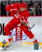 Nicklas Lidstrom Autographed 8x10 Photo #1 - Shooting Puck Ice Spray