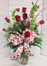 Dozen long stemmed premium Ecuadorean freedom red roses with Bells of Ireland &  Valentine's trim