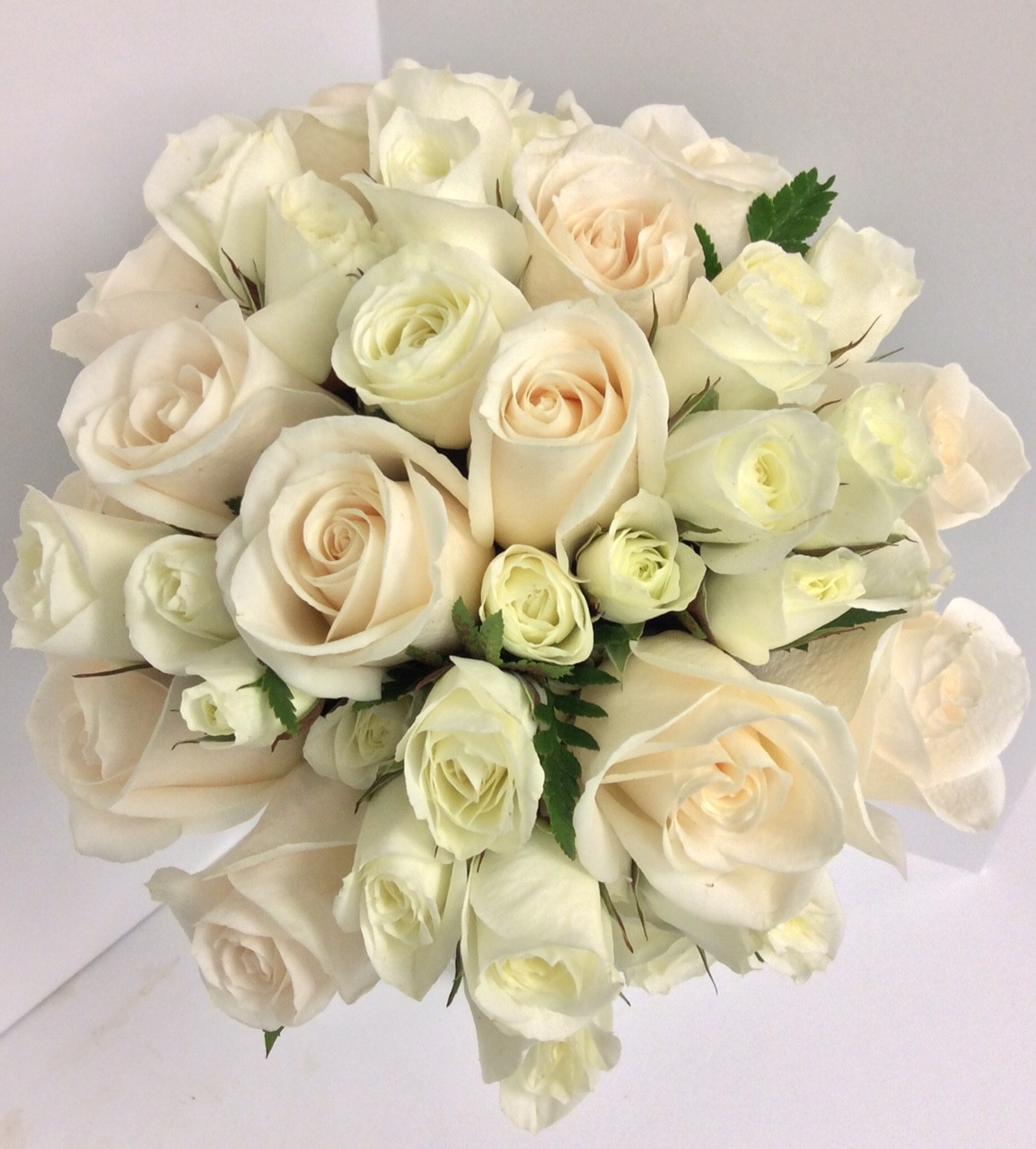 Hand Tied Bridal Bouquet With Standard And Spray Roses In Whites And