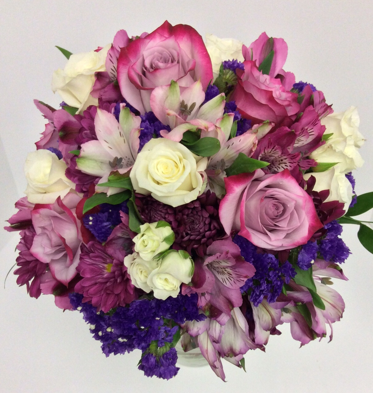 Hand tied round bouquet in purples lavenders and creams hand tied round bouquet in purples lavenders and creams izmirmasajfo