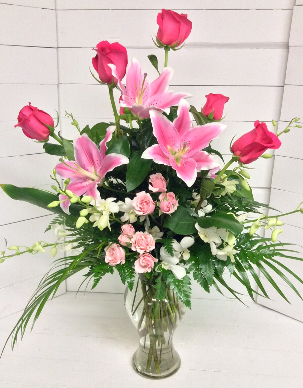 Orchids lilies and hot pink roses with robellini palms image 1 izmirmasajfo
