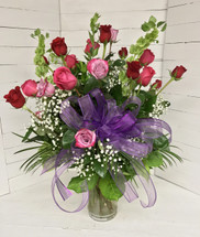 Deep Purple, Hot Pink, and Bright Red Two Dozen Premium Longstemmed Roses Arranged