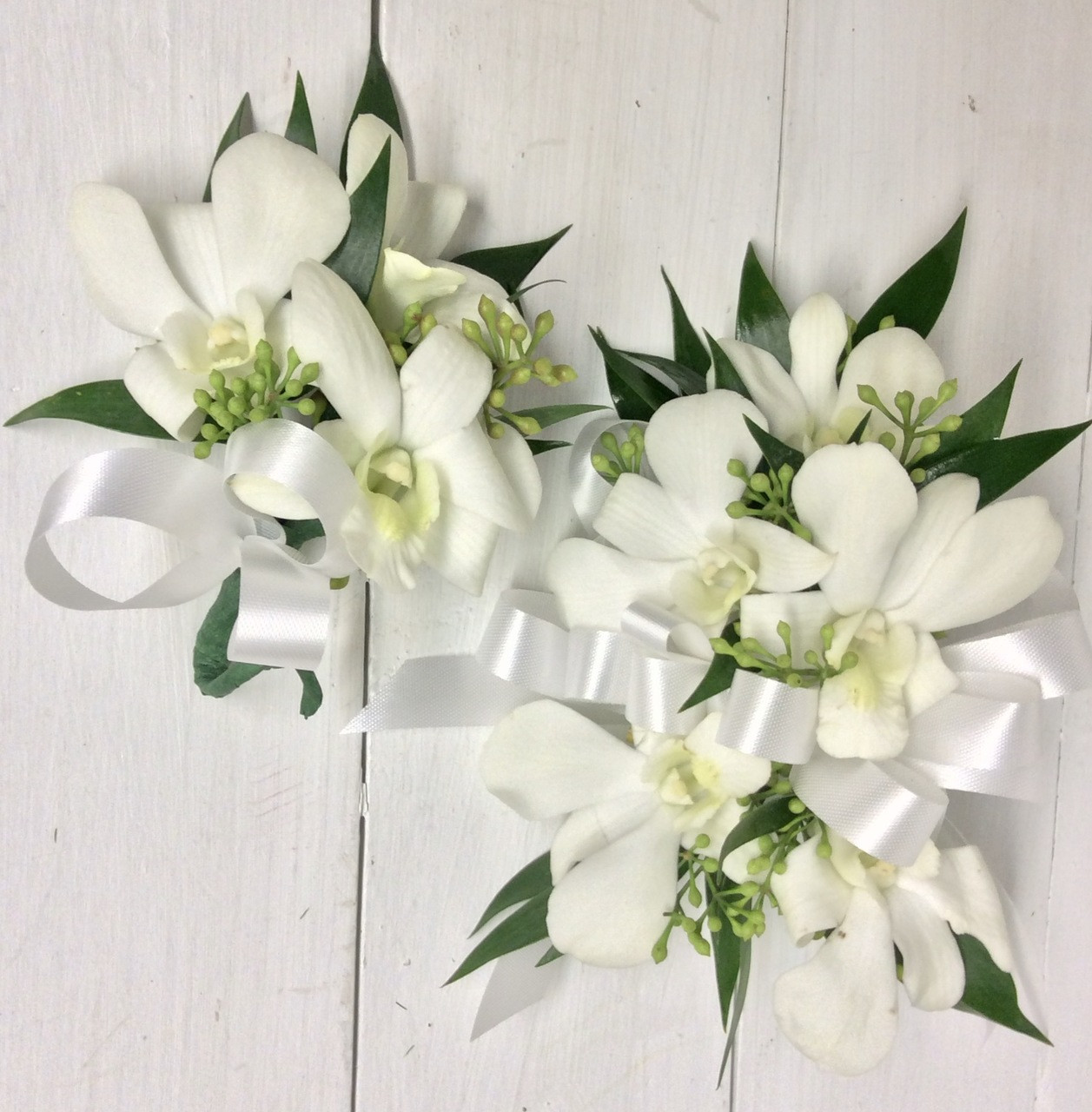 White Orchids And White Satin Wrist Corsage And Boutonnire Combo