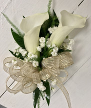 2 mini calla and baby's breath wrist corsage
