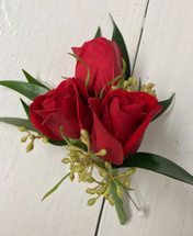 3 red sweetheart and seeded Eucalyptus Boutonnière