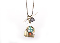 Little bird with cage necklace