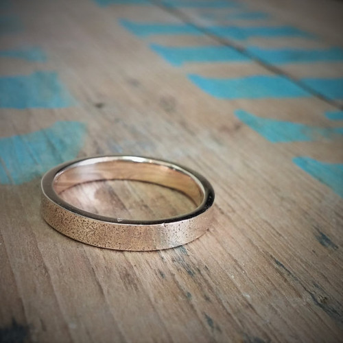 14k gold sand printed wedding band