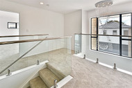 frameless glass balustrade with top capping rail