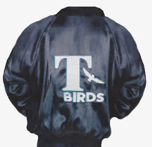 TBJ356C is a 100% polyester satin type fabric that is washable in cold water. Budget price of $24.99 for youth sizes Small, Medium, Large, and XL. T Bird or Thunderbird embroidery emblem on the back and snap enclosure on front. Very good quality for the price.