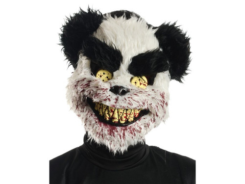 Charles is ready for a new playmate! He ate his last one! This scary teddy bear mask features black and white plush fur with yellow button eyes, sharp yellow teeth and splattered blood from his latest little buddy. Plastic mask is held in place by an elastic strap that goes around the back of the head. Give everyone nightmares for months with this gruesome teddy bear mask!