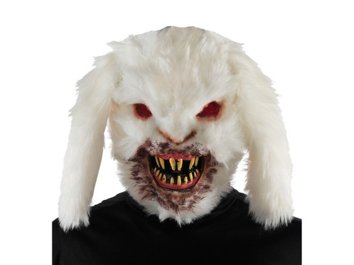 Scare the daylights out of everyone with this gruesome rabid bunny mask. This terrifying mask is made from vacuum-formed plastic, covered in white fur and features red mesh-fabric eyes, long yellow pointy teeth and mouth covered in the blood of his previous victim. Mask is held in place by an elastic strap that goes around the back of the head. Kids will never look at the Easter bunny the same again.