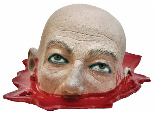 Have you ever wanted a bloody, severed head on a platter?  Well then, this is a perfect prop for your party table and/or halloween display.  This hollow latex head is cut off right below the nose and sitting in a pool of blood. This is sure to get some gruesome looks for all your guests!  Hand painted. Approximately 6 inches tall, 9 inches wide and 13 front to back.