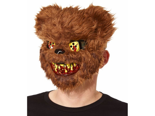 """What happened to Teddy The Scaredy Bear?  We think he has had just about enough!  No one will want to hold you in their arms when you wear this horrifying teddy bear mask.  This creepy teddy bear face features blood-covered teeth and yellow button eyes.    Dimensions:   Width: About 7.5"""" at widest point;  Height: About 9"""" at highest point;   Depth: About 4"""";  Material: PVC, polyester; One size fits most."""