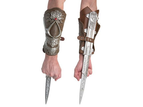 This Assassin's Creed gauntlet is made from faux-leather and ornately decorated with silver and a red stone. Hidden on the underside of the gauntlet is an extendable silver blade. Great accessory for your Ezio costume! Blade is made of safe plastic. This is an officially licensed Assassin's Creed accessory.