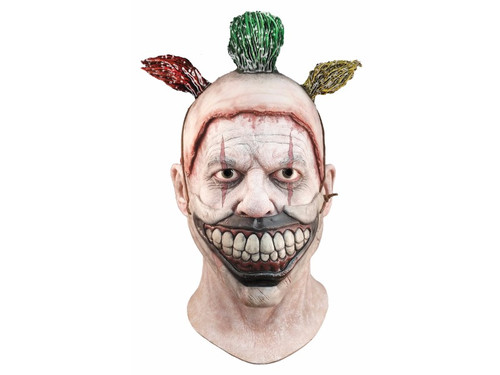 From the horrifying FX network television show American Horror Story comes this great Twisty The Clown Mask! Full over-the-head latex mask of your favorite killer clown. This mask is the same style as our deluxe model but the evil grinning smile is non removable and has painted on hair sprigs. One size fits most adults.