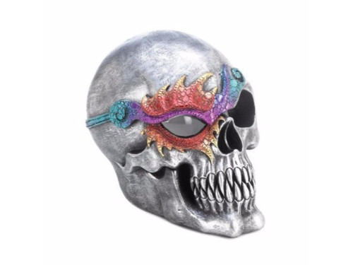 "This cool skull figurine features a silvery finish and a dazzling eye patch that will catch the attention of all who see it. The interior LED light makes one eye glow with spooky splendor. Two ""AA"" batteries not included.  Item dimensions: 7.00"" W x 6.50"" H x 5.50"" L Materials: Polyresin, Led Light"
