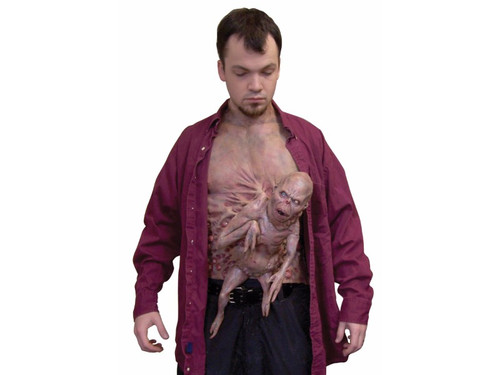 This Deformed Alien Fetus Chest Piece is a unique and unusual costume accessory that will make most run for their life!  As shown, this chest piece comes with a deformed alien style fetus attached. All latex chest piece, attaches with velcro at waist and neck.  Adult. One Size Fits All.