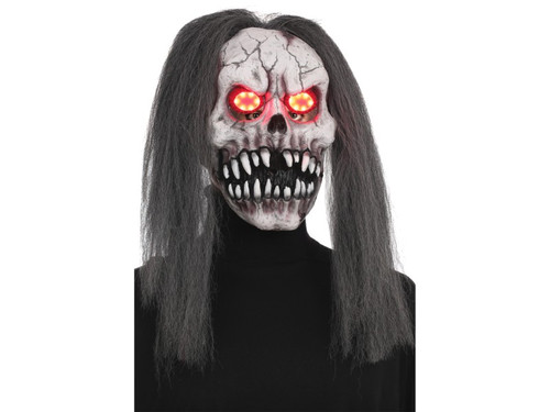 On Halloween the dead will rise, with evil beaming from their eyes! This seriously creepy skull mask features demonic light-up eyes, a large sharp-toothed grin and long scraggly gray hair. Requires 3 AG13/LR44 batteries, not included. One size fits most.