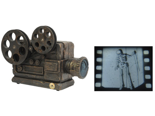 New For 2017! Creepy, old time look projector that shows a rickety dancing skeleton on your wall or screen when activated. Film reels actually turn to give the most realistic look possible. Try me or sound activation included. Measures 8 inches x 4 inches x 10.5 inches. Requires 3 AA batteries. Plastic construction.