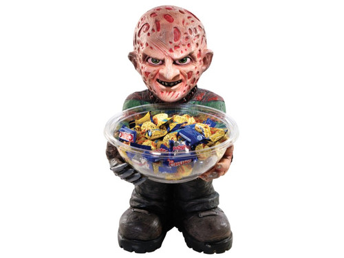 "Freddy Krueger Candy Dish Bowl Holder is crafted from heavy duty foam and stands approximately 18"" tall with a 10"" square base. The back is flat, designed to stand flush against a wall. Also included is the clear plastic candy bowl that fits in Freddy's hand. Add your own candy! Great for Halloween parties or trick-or-treaters!"
