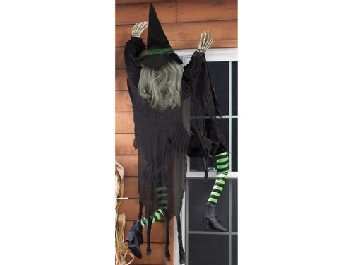 New 2017. Don't look now, but there is a witch outside your window! This witch might have lost her broom, but she is still getting in! This funny Halloween decoration is 5' tall and looks like the backside of a witch, giving the brilliant illusion that the witch is climbing! She is wearing a black tattered jump suit with tattered gauze, black witch hat and green and black striped stocks with boots. 60 inches tall.