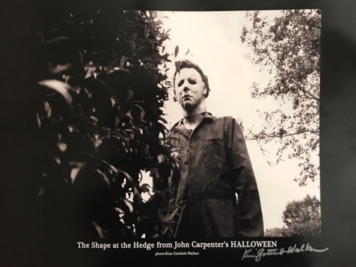 "Michael Myers: ""The Shape At The Hedge,"" From John Carpenter's Halloween.  This 19"" x 13"" print includes an authentic signature from the on set photographer, Kim Gottlieb-Walker. John Carpenter's producing partner, Debra Hill, hired photographer Kim Gottlieb-Walker to be the unit photographer on Halloween, and Kim soon became part of Carpenter's filmmaking family, going on to shoot stills on the sets of some of his most iconic films.  This is a rare find for any 1978 Halloween Movie Collector."