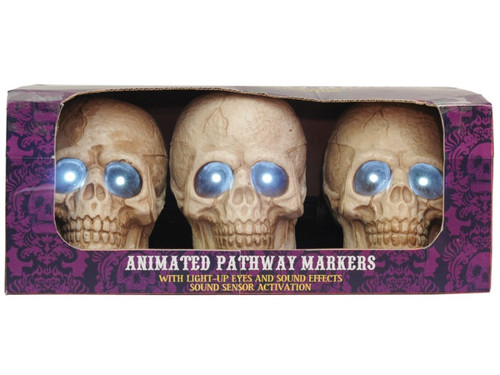 Light-up your pathway with a set of three plastic skulls with ground stakes attached to each. Bright white LED light-up eyes fade in and out and one of four different eerie sound tracks play at each activation. Try me and sound activation included. Requires 3 AA batteries. Skulls measures 6.5 inches x 4 inches x 6 inches. Skulls can be displayed a distance of two feet apart.