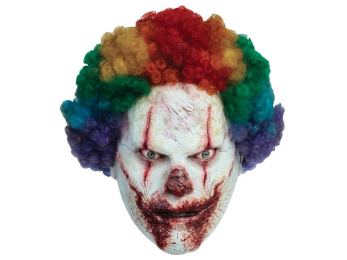This clown will frighten even the bravest of souls! Crafted from high-quality latex, this detailed scary clown mask features a full head construction with attached curly rainbow hair. His face looks as though it came from a nightmare, with white clown paint barely covering his scars, and blood oozing from the fresh cuts on his eyes and mouth.