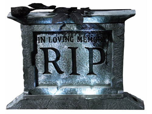 "Granite-look 22 inch light-up tombstone with pedestal with white strobe lights that require 3 AAA batteries. Batteries not included. Lightweight polyfoam. Width is 2 1/2 inches. Tombstone has black plastic rose attached, with ""In Loving Memory RIP"" printed on the front. Styrofoam prop with realistic granite finish. Installation instructions included. Prop can be displayed on-ground or in-ground. Battery replacement instructions included. Materials included: (1) tombstone, (2) ground stakes, (1) black rose. Decoration-Not a toy. Recommended for ages 15 and up. Measurements: 15 in. x 20.5 in. x 2.5 in."