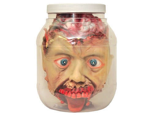 Jaw-dropping prop of a severed head in a plastic jar. Add water for a more realistic effect. Leave sitting out on counter or in your evil laboratory for the best effect. Prop is 7 inches tall, 6 inches wide.