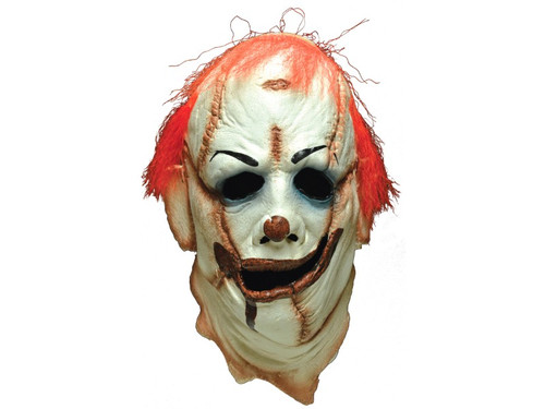 Sculpted by Justin Mabry. No detail was missed in this incredible mask of The Clown Skinner from the Fox TV show, The Following. All parts of the face and body were used to construct this mask, including a pierced belly button navel for one of the ears. Comes with strap to attach your own face.