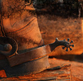 The Heel Of A Cowboy Boot And Spur In A Grungy Texture And A Glowing Sunset. Photograph
