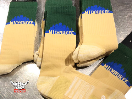 Proud to partner with Strideline socks to present the 414 Milwaukee Cream City edition socks. These dudes are the cutting edge in footwear socks. Cream base with green top in a true blue city skyline. With sweat wicking technology these 414 cream city socks are enhanced to keep your feet dry in the most extreme sweating conditions. Sock materials white speckle Nylon 32% Polyester 20% Cotton 43% Elastic 3% Spandex 1 % Rayon 1%