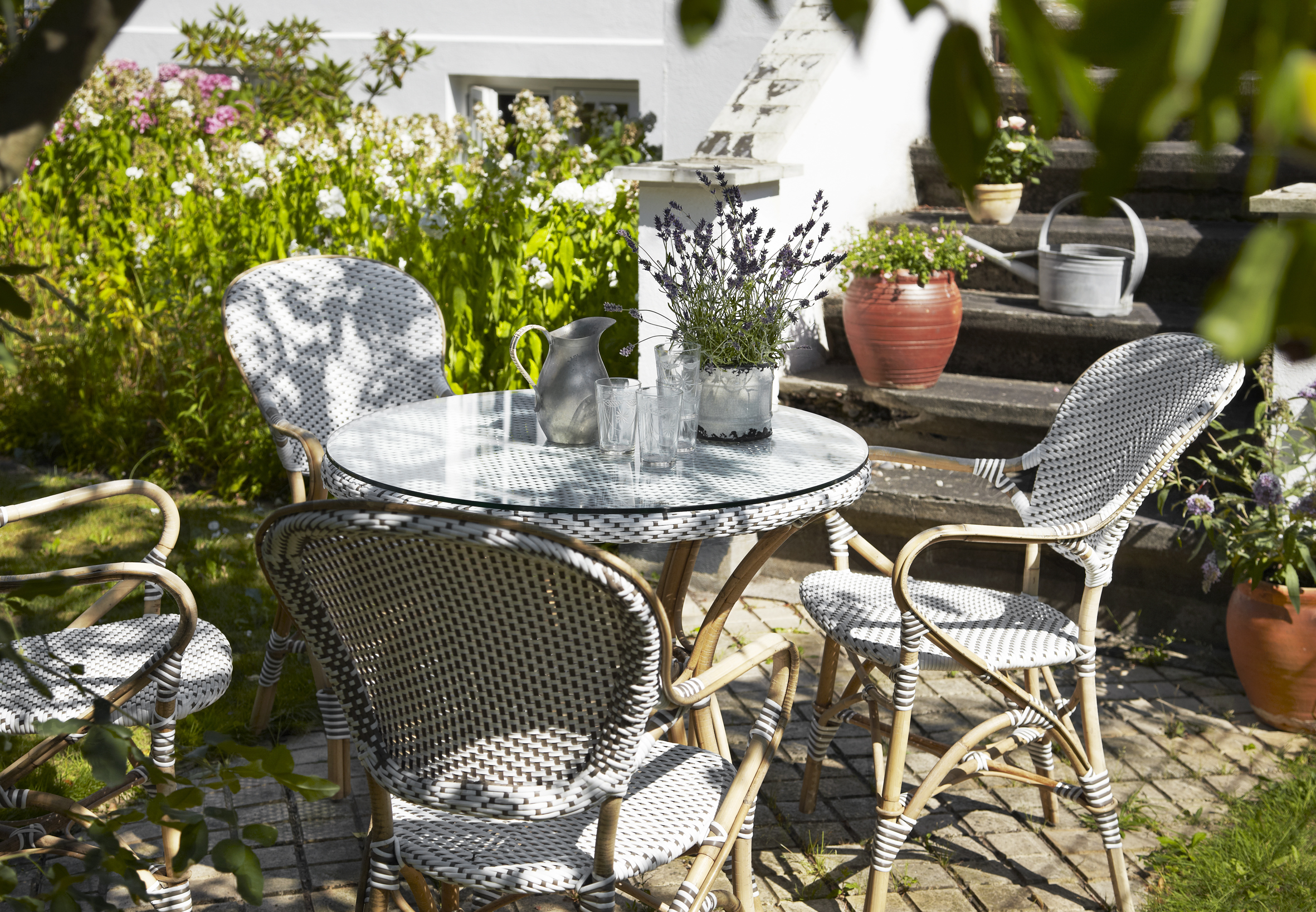 Sika Design Isabell rattan chairs and table on patio